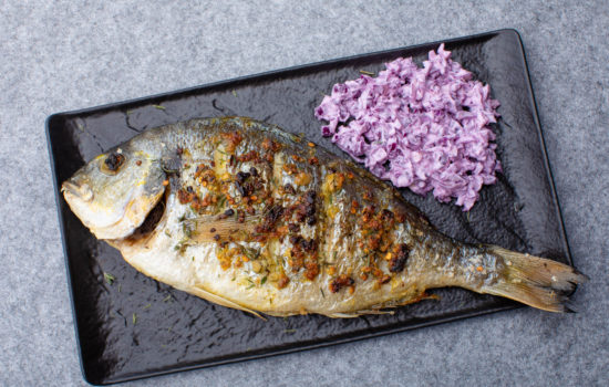 Grilled whole dorada with red cabbage salad